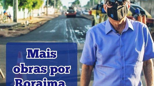 Jucá de Máscara anda em via com obra de asfalto em Boa Vista Roraima com máquinas ao fundo